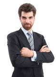 Businessman Portrait. Portrait of young businessman is standing with arms crossed and looking at camera Stock Photography