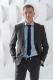 Businessman portrait on background of modern abstract urban inte Royalty Free Stock Photos