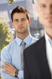 Businessman portrait with colleague Stock Images