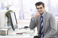 Businessman portrait at desk stock photography