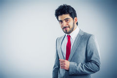 Businessman portrait. Grey background eyes to the camera Royalty Free Stock Image