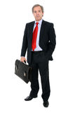 Businessman portrait holding a briefcase. Businessman holding a leather briefcase isolated on white background stock images