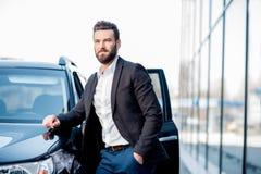 Businessman portrait near the car Stock Images
