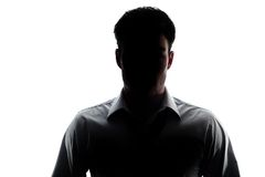 Businessman portrait silhouette wearing a open collar shirt Stock Photography