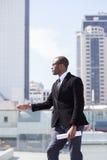 Businessman portrait on skyscrapers background Stock Photo