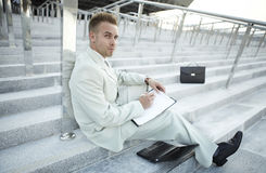 Businessman portrait on stairs Stock Photography