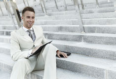Businessman portrait on stairs Royalty Free Stock Image