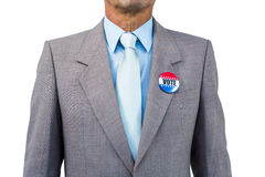 Businessman posing with badge. On white background Stock Photo