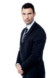 Businessman posing in clasped hands Stock Photo