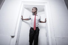 Businessman posing in a doorway Royalty Free Stock Photos