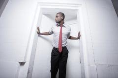 Businessman posing in a doorway Royalty Free Stock Photos