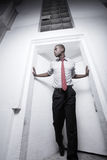 Businessman posing in a doorway Royalty Free Stock Images