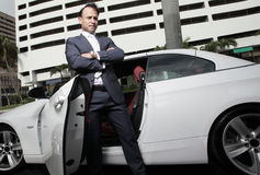 Businessman posing by his car Stock Photography