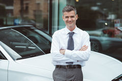Businessman posing with his new car Royalty Free Stock Photo