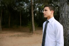 Businessman posing relaxed on a park forest Stock Images