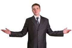 Businessman posing in a suit. Young businessman posing in a suit isolated in white Royalty Free Stock Photos