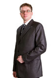 Businessman posing in a suit. Young businessman posing in a suit isolated in white Royalty Free Stock Photography