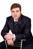 Businessman posing in a suit. Young businessman posing in a suit isolated in white Stock Photo