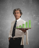 Businessman and positive statistics stock images