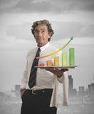 Businessman and positive statistics Stock Photos