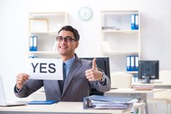 The businessman in positive yes answer in the office. Businessman in positive yes answer in the office royalty free stock photo