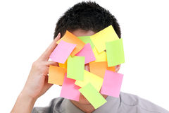 Businessman with post-it. Businessman with plenty of colorful post-it on his face Royalty Free Stock Image