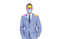 Businessman with post it on his face Stock Images