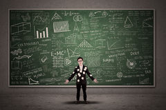Busy businessman with chalkboard Stock Image