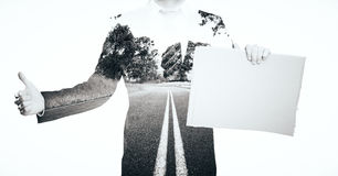 Businessman with poster Stock Photo