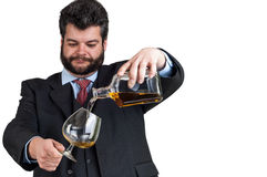 Businessman pouring  a glass of whisky Stock Photography