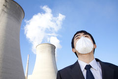 Businessman at power plant with face mask Royalty Free Stock Photos