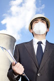 Businessman at power plant with face mask Stock Images