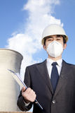 Businessman at power plant with face mask Royalty Free Stock Image
