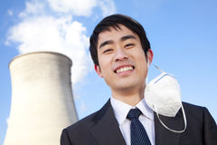 Businessman at power plant with face mask Royalty Free Stock Images