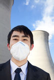 Businessman at power plant with face mask Stock Photos