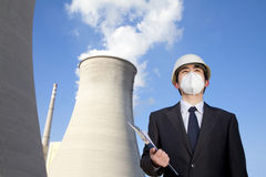 Businessman at power plant with face mask Stock Image