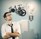 Businessman powering a big idea Royalty Free Stock Photos
