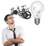 Businessman powering a big idea Stock Image