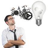 Businessman powering a big idea stock image