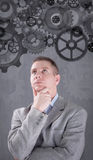 Businessman powering a big idea with a gear system Stock Photography