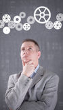 Businessman powering a big idea with a gear system Stock Photos
