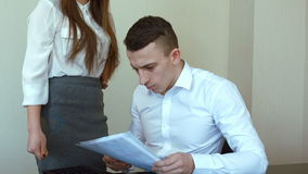 Businessman praises his colleague for a job well done stock video footage