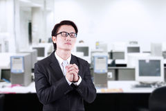 Businessman pray at office Stock Photography