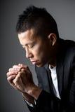 Businessman pray. On white Royalty Free Stock Photo