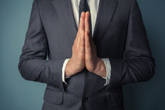 Businessman in prayer Royalty Free Stock Photo