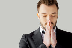 Businessman praying. Stock Photo