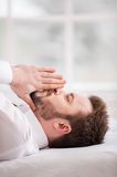 Businessman praying. Stock Images