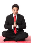 Businessman praying Royalty Free Stock Photography