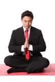 Businessman praying Stock Images