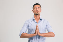 Businessman praying with closed eyes Royalty Free Stock Photo